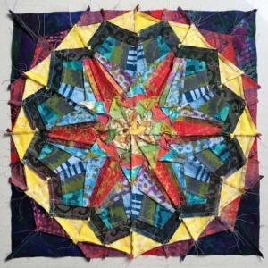 Achterkant kaleidoscope blok van Afrikaanse batiks - naadjes nalopen