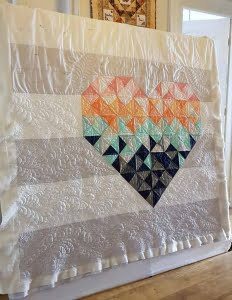 Piece and Love quilt deels gevuld met filler quilting
