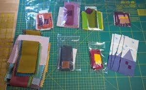 plastic zakjes met voorverpakte quilt blokken als projecten