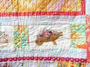 Quilt gezien in Deventer met detail van a walk in my garden quilt
