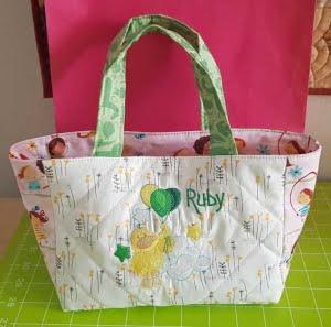 Geborduurd tasje voor pasgeboren baby